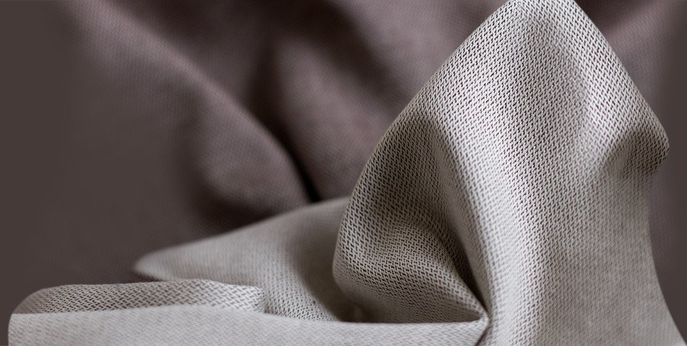 Closeup of the fabric of the Fidella Chevon -plain umber- babywrap