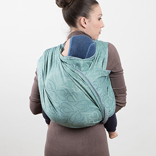 Fidella Giselles back carry - tied_at_shoulder instruction step 14