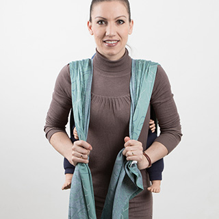 Fidella Giselles back carry - tied_at_shoulder instruction step 8