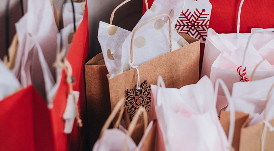 Full shopping bags made of paper in Christmas design